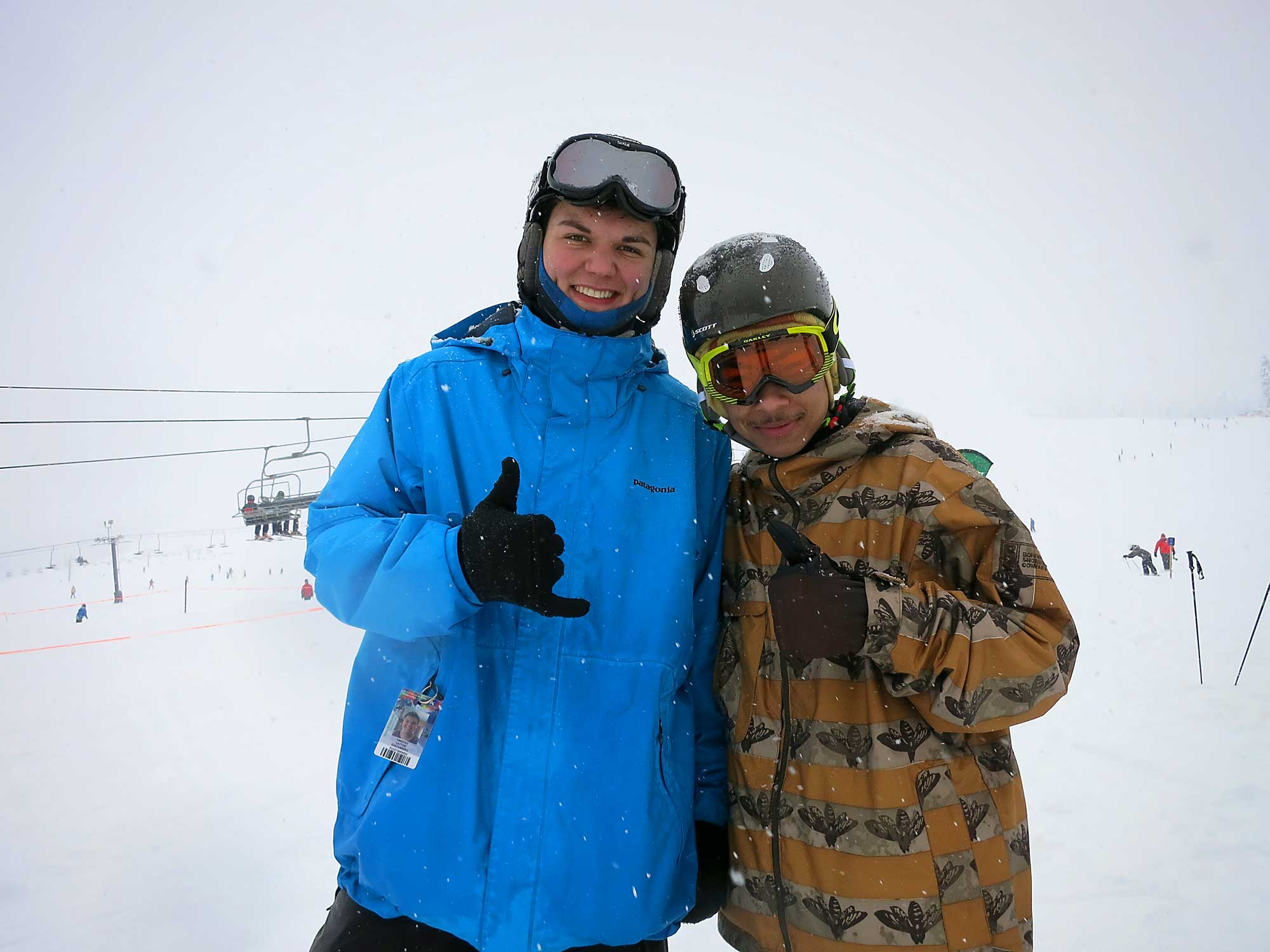 Tim (left) and one of our Peer Leaders, Masra (right) taking a break from all the POW for our tSB Photographer!